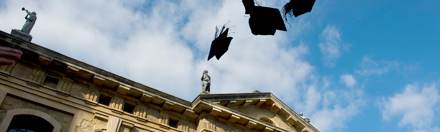 Mortar boards in the air above Sheldonian