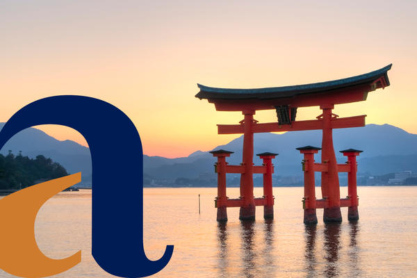 The Great Torii gate of Miyajima Island, with the alumni logo imposed to the left of the picture