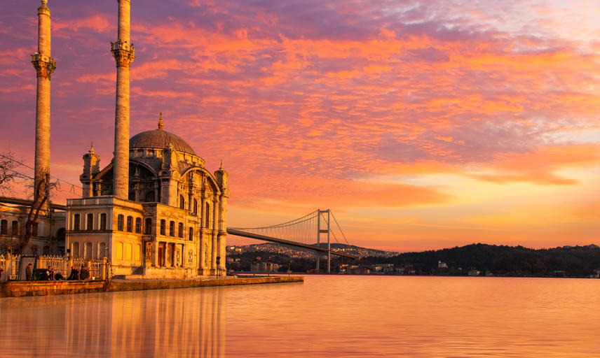The Ortakoy Mosque in the foregound and Bosphorus Bridge in the background, at dusk