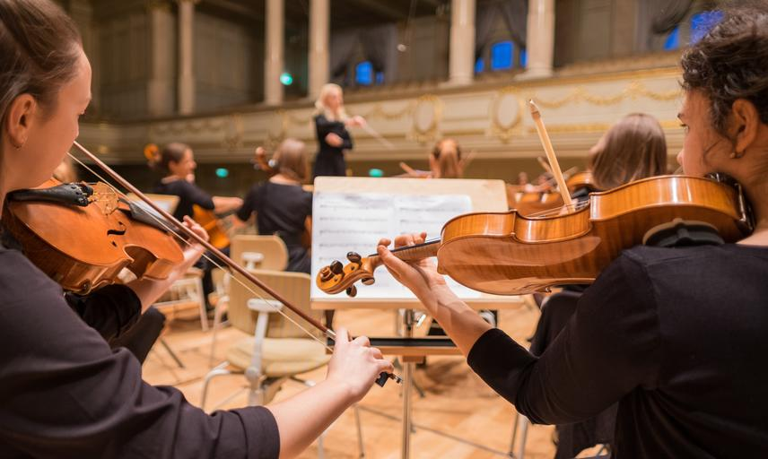 Orchestra music - two women playing violin
